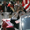 Marblehead: While being driven in a red corvette, para olympic sailing gold medalist, Maureen McKinnon-Tucker, takes a few pictures of the parade in her honor from her point of view. Starting at the Old Town House, Tucker was driven in a red corvette through the streets of downtown ending with a ceremony at Fort Sewall.<br /> Photo by Deborah Parker/Salem News Saturday, September 20, 2008