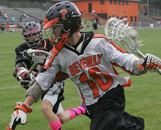 Beverly's Brendan Crowley is defended by Whitman Hanson Regional's  Alex Clemens during yesterday's East Division 2 preliminary round game held at Hurd Stadium in Beverly. Photo by Deborah Parker/June 2, 2010