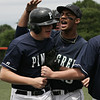 Pingree's Brendon Oliver is congratulated by Lamar Rey after sliding into home plate to score during Saturday's New England Small School Baseball Championships held at Salem State College. Photo by Deborah Parker/May 23, 2009