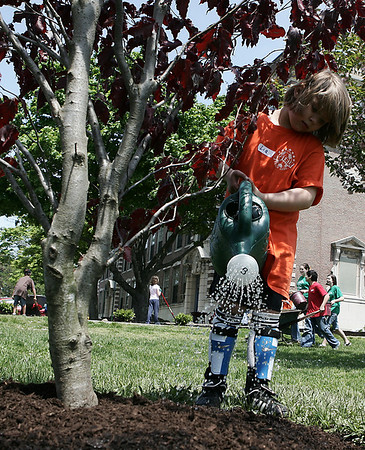 """Beverly: Lia Whitehair, 6, of Beverly helps to water a newly planted tree while attending the Build a Better Briscoe Community Day at Briscoe Middle School.  Volunteers helped to place mulch and plant flowers and shurbs in the front of the building. Every elementary school also donated a tree, which will be planted along Colon Street, and named """"Elementary Way."""" Photo by Deborah Parker/May 16, 2009"""