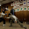 Peabdoy: Rafael Rivera, 11, of Peabody, left and Troy Sliney, 9, of Haverhill practice a fencing drill during the Tanner City Fencing Club practice held at Higgins Middle School Wednesday evening. Coach Molly Sullivan Sliney is a former Olympian and partner coach, Jane Carter is a Pan American games gold medalist. Photo by Deborah Parker/Salem News Wednesday, December 17, 2008.