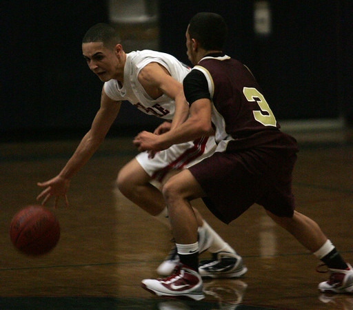 North Shore Tech's Jordan Castillo is defended by Whittier's Gogio Gomez during last night's game held at North Shore Technical High School. PHoto by Deborah Parker/January 15, 2009