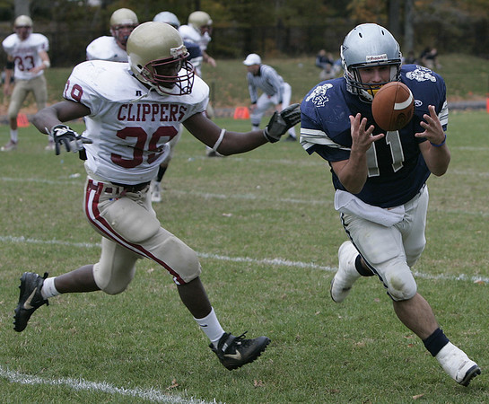 Hamilton:**(There was no roster)** Hamilton's Stephen Dangora gains control of the ball just before being tackled by Newburyport's #39 during yesterday's game at Hamilton. Newburyport defeated Hamilton 28-14.<br /> Photo by Deborah Parker/Salem News Saturday, October 25, 2008