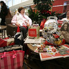 Donna Chaloner of Georgetown and Jane Papasodoro of Saugus bond over their mutual Black Friday shopping experience while resting at the North Shore Mall Friday morning. This was Papasodoro's frist Black Friday. Photo by deborah parker/november 26, 2010