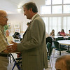 Congressman John Tierney greets Danvers resident Frank Tyrrell, a strong republican, who was interested in asking Tierney questions about elder services while at the Danvers Council on Aging Tuesday.  The visit is part of Tierney's Listening Tour. PHoto by Deborah Parker/August 17, 2010