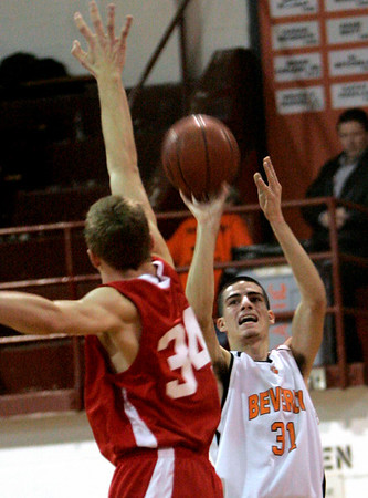 Beverly: Saugus' Chris Finn tries to block Beverly's Curtis Manuel's shot on hoop yesterday's game at Beverly High School. Photo by Deborah Parker/Salem News Friday, January 23, 2009.