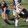 Danvers' Taryn Pydnkowski fights for control of the ball against Beverly's Corinne Woods during yesterday's game held at Beverly High School. Photo by Deborah Parker/September 10, 2009