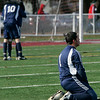 Lowell: Hamilton-Wenham's Andres Laverde kneels on the field after loosing 4-2 in the Division 3 State Championship to Bromfield. Photo by Deborah Parker/Salem News Saturday November 22, 2008.