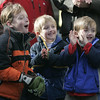 Marblehead: From left, Will Cleary, 8, and friends, Peter and Brody Clifford, 4, all of Marblehead cheer from the sidewalk waiting to be thrown candy during the Christmas parade in Marblehead Saturday. Photo by Deborah Parker/Salem News Saturday, December 06, 2008