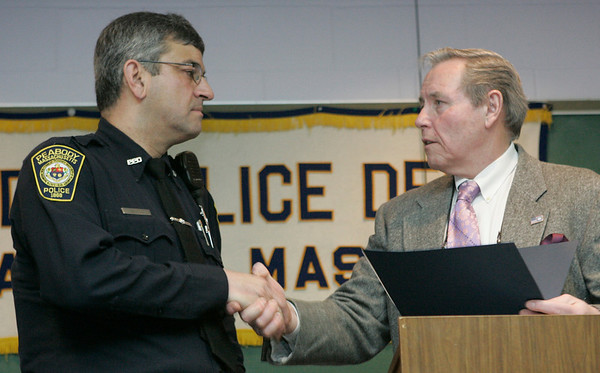 Peabody: Officer Antonio Santos receives a letter of recommendation from Peaody Police Chief Robert L. Champagne during the department's annual Commendation Ceremony yesterday afternoon. Photo by Deborah Parker/Salem News Wednesday January, 28, 2009.