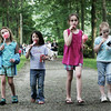 From left, Avery Scharffenberg, 6, Jade Poirier, 6, Chloe Scharffenberg, 8, and Julia Ryan, 7, walk through the property at Glen Magna Farms with their snacks of cotton candy and ice cream while at the History, Harmony, Hotdogs & Hits event as part of Danvers Family Festival Monday evening. The event included an old time baseball game, jazz, hot dogs, root beer floats, and a bouncy house. Photo by Deborah Parker/June 29, 2009