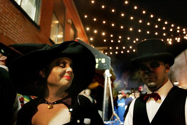 Merritt and Kris Kirkpatrick of Salem waits in line for the Salem Wax Museum during Halloween evening Saturday. Photo by Deborah Parker/October 31, 2009