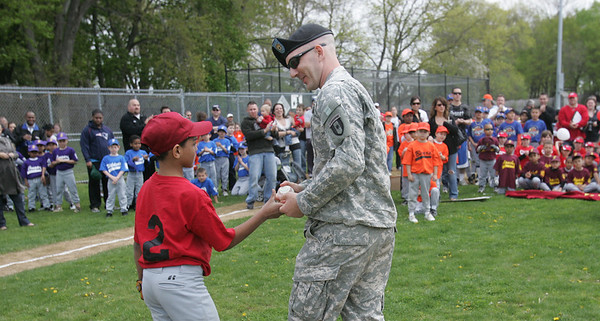Ricardo Troncoso of the Diamondbacks hands Kevin Neylon of Salem the ball after cathing the first pitch of the season from Neylon during the Annual Salem Little League opening ceremonies Sunday morning. Starting at Salem State College, the parade crossed Lafayette Street and ended at Forest River Park. Photo by Deborah Parker/April 25, 2010