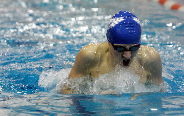 Salem: St. John's Bredan Sweeney completes the last leg of the 100 meter breast stroke during yesterday's Catholic Conference Meet against B.C. High held at Salem State College. Photo by Deborah Parker/Salem News Saturday January 31, 2009.