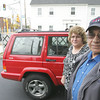 Last spring, the city put in a new traffic light at the intersection of Washington Street and Allen's Lane. It has caused headaches for Sotirios Korisianos and his wife Bessie. When they pull out of their driveway, they can't tell if the light is red or green and they often find that the traffic blocks their access to the driveway from the street. Photo by Deborah Parker/November 10, 2009