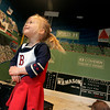 Marblehead: Jenny Aikman, 2, smiles up at her mom while Cape based artist, Hans de Castellane, a creates a mural of Fenway Park inside their Marblehead Home. Photo by Deborah Parker/Salem News Monday, April 6, 2009.
