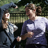 Alexandra Kapantais and Cristina Capra watch at their paper balloon was released into the air yesterday afternoon at the Collins Middle School in Salem A group of seventh graders all gathered outside the school yesterday to watch their balloons filled with propane and to see how far they would travel. Photo by Deborah Parker/September 21, 2010