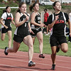 Beverly: From left, Salem's Casey Lavoie, Beverly's Helem Amore and Heidi Bezemes, and Salem's Desiree Deleon compete in the 100 meter spring during yesterday's meet held at Beverly High School. Photo by Deborah Parker/May 20, 2009.