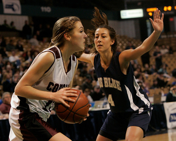 Worcester: Swampscott's Marissa Gambale defends the hoop against Quaboag's Olivia Jenkins during Saturday's State Finals game held at the DCU Center in Worcester. Photo by Deborah Parker/Salem News Saturday March 14, 2009.