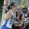 Danvers' Katharine Jennings is defended in front of the net by Weston's Anna Duffy during yesterday's Division 2 North state tournament quarterfinal held at Deering Stadium in Danvers Monday evening. Photo by Deborah Parker/June 7, 2010