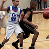 Wenham: Seventh grader Isaiah White of Beverly is defended by Lynn's Fred Hogan in front of the net while competeing in  Eastern League travel Championships held at Gordon College Saturday morning. Photo by Deborah Parker/Salem News Saturday, March 21, 2009.