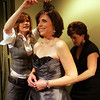 Michele Mathers and Heidi Nicholson of Bella Sera Bridal prepare Boxford resident Christina Eckert for her reveal after she won a makeover as part of the Boxford Elementary School Trust's fashion show fundraiser held at the Ipswich Country Club Wednesday evening. photo by deborah parker/february 3, 2009