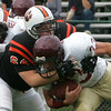 Beverly's Mark Pappas brings down Gloucester's #33 during yesterday's game held at Hurd Stadium. Photo by Deborah Parker/October 4, 2009