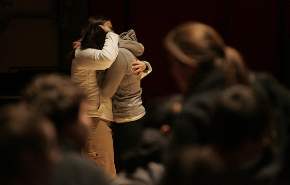 Student Edi Baliqi receives a hug from Salem High Social Studies teacher Beth Factor after sharing an emotional response to Rachel's Challenge. Racehl's Challenge is a tolerance program based on one of the victims of the Columbine shooting. The goal is to create a safe learning environment ofr students by re-establishing civility and quelling school violence and bullying. Photo by deborah parker/december 7, 2010