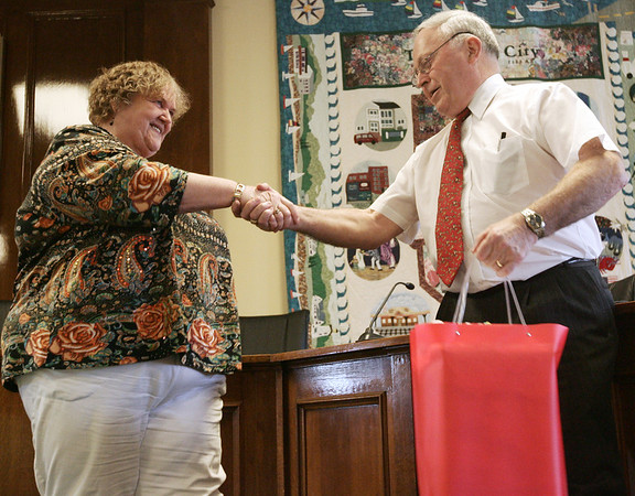 Beverly mayor Bill Scanlon congratulates Brenda Sumrall for her service to the city during a retirement party held at City Hall Thursday afternoon for 14 city employees who took voluntary early retirement as a way for the city to save money. Photo by Deborah Parker/June 25, 2009.