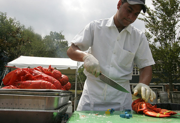 Luciano Morias of Creative Catering prepares lobster to be served during the Lobster Festival part of this year's Beverly Homecoming. photo by Deborah parker/august 4, 2010
