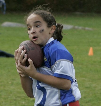 Peabody: Kayla Santos cradles the ball after completing a pass during their flag football game at Emerson Park Saturday. Photo by Deborah Parker/Salem News Saturday, October 25, 2008