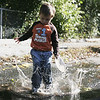 Peter Mooradd, 3, of Ipswich, has some fun jumping through some puddles while at the Ipswich Fire Station during their open house Saturday morning. Photo by Deborah Parker/October 9, 2010