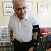 Manuel Machado, a stroke victim from Peabody, deomonstrates a new robotic brace now available to help stroke victims recover the use of their arms. Northeast Senior Health, which runs Ledgewood, said they are the first organization in the country to use the MIT-developed technology, called Myomo, which stands for My Own Motion. Photo by Deborah Parker/January 27, 2009