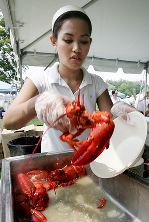 Izzy Pulido with Creative Catering of Beverly plates up a lobster during the Lobster Festival at Lynch Park, part of Beverly Homecoming. Photo by Deborah Parker/August 5, 2009