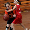 Peabody: Center School's Andrea Beaudrealt is defended by South School's Kara MadDonald during yesterday's final game in Peabody's 5th Grade Elementary Basketball League.  Photo by Deborah Parker/Salem News Thursday, March 12, 2009.