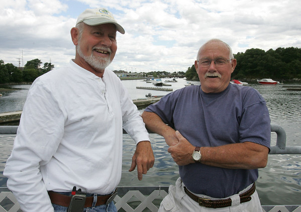 Fuzzy Faulstich, left, and Carl Larcom, both of Beverly, attend a bbq at the Bass Haven Yacht Club in Beverly in honor of its 100th anniversary Thursday evening. Photo by Deborah Parker/July 2, 2010