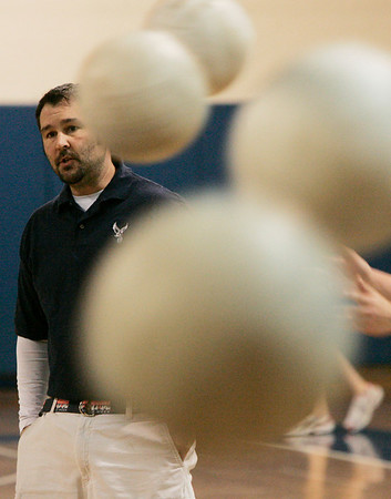 Danvers: St. John's volley ball head coach, gives advice to his team as they practice drills yesterday afternoon. Photo by Deborah Parker/Salem News Thursday, March 26, 2009.