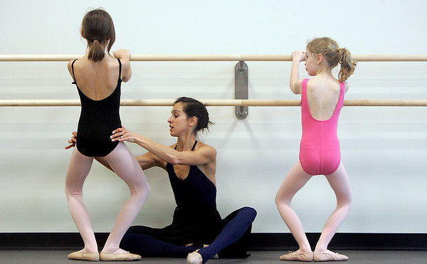 Marblehead: Boston Ballet dance teacher,Alicia Macdonald teaches Noa Minelli, left, and Lisa Owen how to demi plie during dance class at the Boston Ballet School located in the new Marblehead YMCA.  Photo by Deborah Parker/Salem News Thursday, February, 12, 2009.