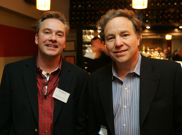 David Ashton and Brad Dobrein, both of Salem, pose for a picture while attending a cocktail reception at Sixty2 on the Wharf to kick off the bicentennial year of the Salem Athenaeum. Photo by Deborah Parker/January 12, 2009.