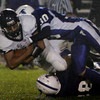 Lynnfields Gino Cohee is brought down by Danvers'  Nick Valles during last night's game held at Deering Field. Photo by Deborah Parker/October 9, 2009