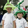 Richard Andrews, 5, of Beverly and his brother Abraham, 3, pose together with alien balloon hats they had made while attending the Beverly Arts Festival on Cabot Street Saturday. Along with art vendors there were games for kids, a dj, and food. Photo by Deborah Parker/June 20, 2009.