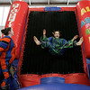 Beverly: Hannah Burke, 12, of Beverly, left, watches at Tasia Kendall, 14 of Gloucester sticks herself to an inflatable velcro wall during All About Fun Inc.'s fundraiser for the North Shore Music Theatre held at Beverly High School Saturday. All About Fun is a party rental company located in Boxford.  They have taken direct action to help the North Shore Music Theatre with their ÒSave Our TheatreÓ Campaign. The event featured an obstacle course, sumo wrestling, carnival games, food and face painting. Photo by Deborah Parker/Salem News, Saturday, January 17, 2009.