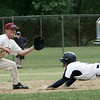 Peabody's Marc Finocchio dives safely into second base against Lowell's Kyle Gath during yesterday's Division 1 North Baseball playoff game held at Peabody's Veteran's Memorial High School. Photo by Deborah Parker/May 31, 2009