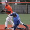 Salem State's Troy Ingemi looks to throw to first as Brandeis' Drake Livada slides into second during yesterday's game held at Salem State College. Photo by Deborah Parker/March 22, 2010