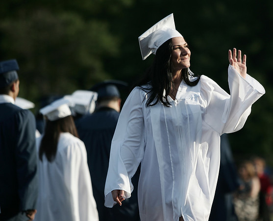 Klamida Cela waves to the crowd before receiving her diploma during Peabody Veterans Memorial High School graduation Friday evening. Photo by Deborah Parker/June 12, 2009