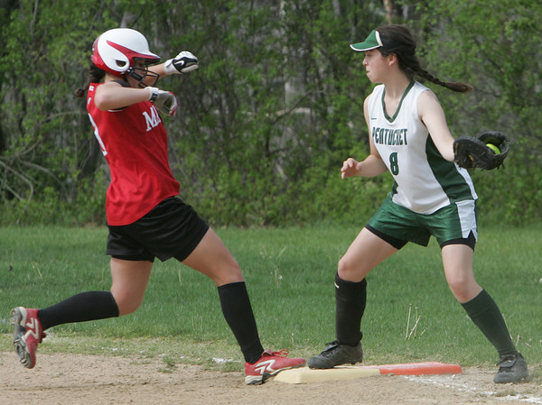 Masco's Katie Guido makes it safely back to teh plate before Pentucket's Bernedette Corrado can make the tag during yesterday's game. Photo by Deborah Parker/may 7, 2010