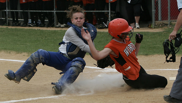 Danvers' Jillian Carroll tags Woburn's Kim Dulong for the out during yesterday's Division 1 North semifinals game held at Martin Park in Lowell. Photo by Deborah Parker/June 4, 2009