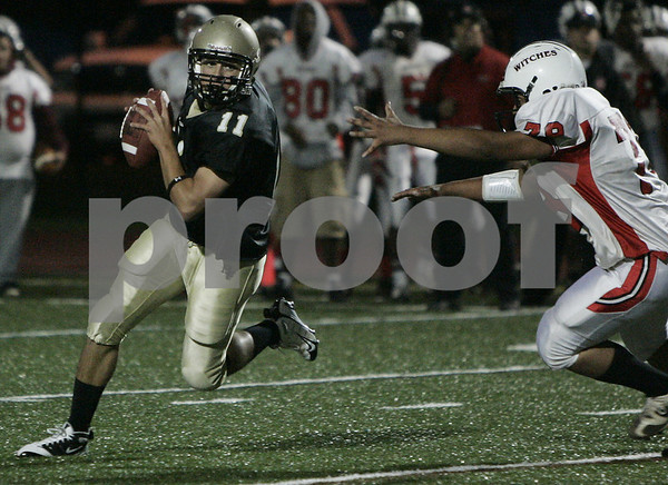Peabody: Bishop Fenwick's Pat Holleran gets rid of the ball before the tackle is made by Salem's Louis Montalvo during last night's game held at Bishop Fenwick. Photo by Deborah Parker/Salem News Friday, September 19, 2008