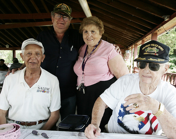 From left, George Mello of Salem, Commander Bruce Salaman, of Salem,  Vinny Cavanaugh, of Salem and John Cavanaugh of Beverly attend the Salem Witch City Post 1524, VFW, barbeque held at Camp Naumkeag Saturday. Photo by Deborah Parker/August 22, 2009