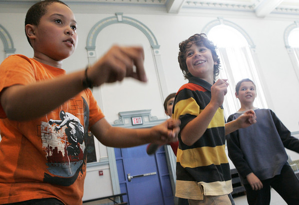 Salem: From left, Saltonstall School students Angel del jesus Capellan, Isaac Vural and Troy Welling warm up during dance class taught by Carl Thomsen as part of the special legends program at the school. The students were learning a dance to a song about the midnight ride of Paul Revere. Photo by Deborah Parker/Salem News Wednesday, January 14, 2009.